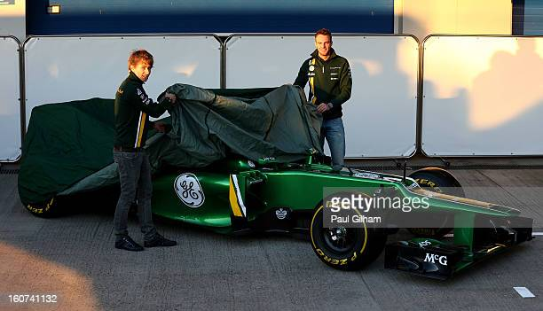 Charles Pic of France and Caterham and Giedo van der Garde of Netherlands and Caterham unveil the CT03 car at the Caterham F1 launch during Formula...