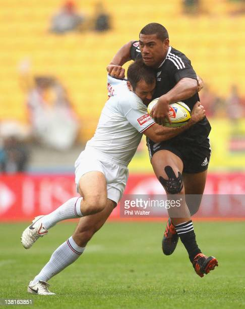 Charles Pitau of New Zealand is tackled by Renaude Delmas of France during the match between New Zealand and France on day two of the Wellington...