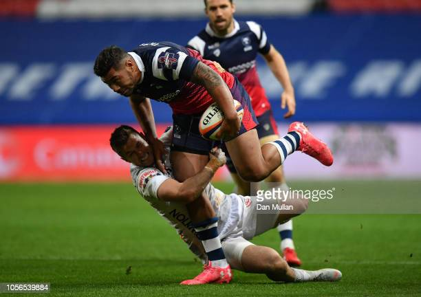 Charles Piutau of Bristol is tackled by Henry Trinder of Gloucester Rugby during the Premiership Rugby Cup match between Bristol Rugby and Gloucester...