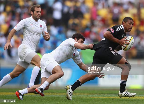 Charles Piutau of New Zealand is tackled by Mat Turner of England during the match between New Zealand and England on day two of the Wellington...