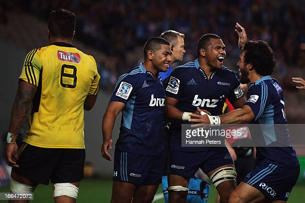 Charles Piutau of the Blues celebrates after scoring a try with Peter Saili and Rene Ranger during the round nine Super Rugby match between the Blues...