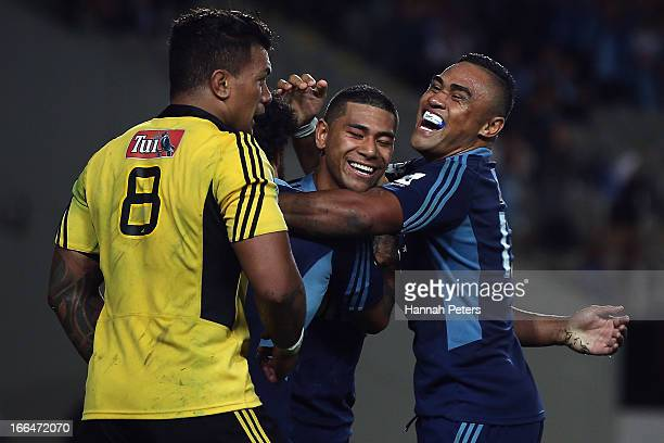 Charles Piutau of the Blues celebrates after scoring a try with Francis Saili during the round nine Super Rugby match between the Blues and the...