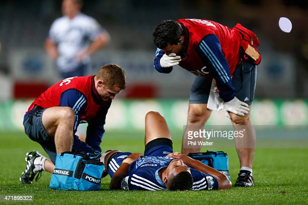 Charles Piutau of the Blues lies injured on the field during the round 12 Super Rugby match between the Blues and the Force at Eden Park on May 2,...