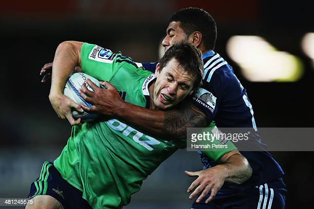 Charles Piutau of the Blues tackles Ben Smith of the Highlanders during the round seven Super Rugby match between the Blues and the Highlanders at...