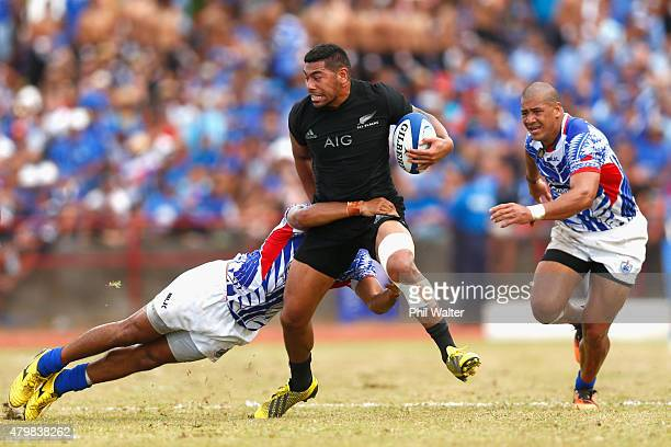 Charles Piutau of the New Zealand All Blacks is tackled during the International Test match between Samoa and the New Zealand All Blacks at Apia...