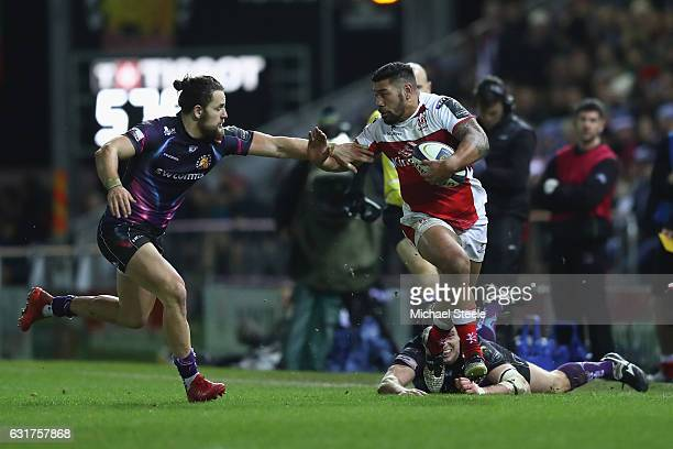 Charles Piutau of Ulster hands off Michele Campagnaro of Exeter looks on during the European Rugby Champions Cup Pool 5 match between Exeter Chiefs...