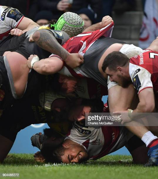 Charles Piutau of Ulster is caught at the bottom of a scrum during the European Rugby Champions Cup match between Ulster Rugby and La Rochelle at...