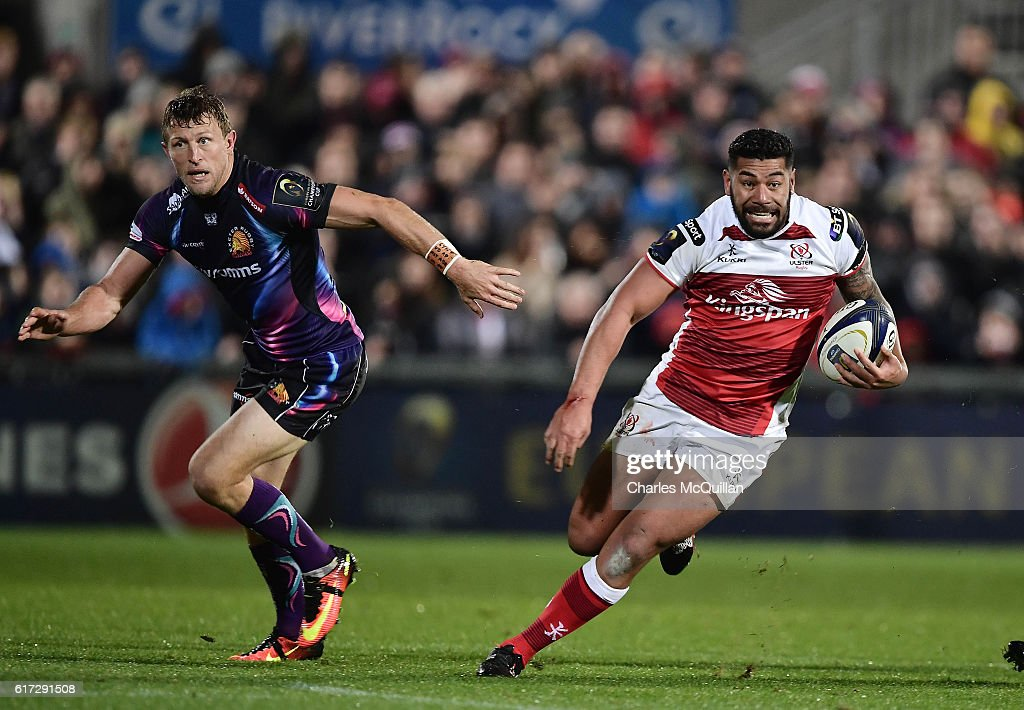 Charles Piutau (R) of Ulster runs at the Exeter defence during the Champions Cup Pool 5 game between Ulster Rugby and Exeter Chiefs at Kingspan Stadium on October 22, 2016 in Belfast, Northern Ireland.