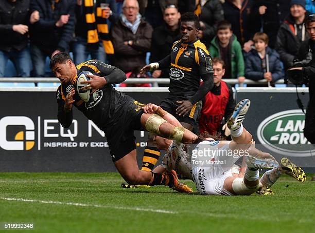 Charles Piutau of Wasps dives in to score a try in the last minutes of the match during the European Rugby Champions Cup Quarter Final match between...