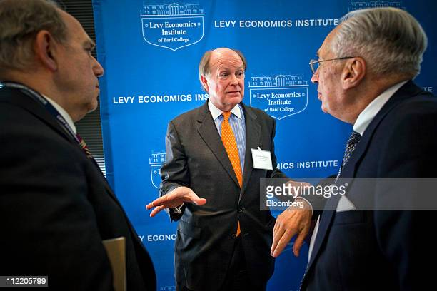 Charles Plosser president and chief executive officer of the Federal Reserve Bank of Philadelphia center speaks with attendees after speaking at the...
