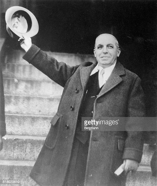 Charles Ponzi waves his hat as he leaves a prison in Charleston South Carolina USA