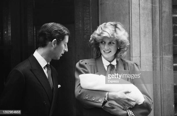 Charles, Prince of Wales and Diana, Princess of Wales leave the Lindo Wing of St Mary's Hospital with their son Prince Harry, in Paddington, London,...