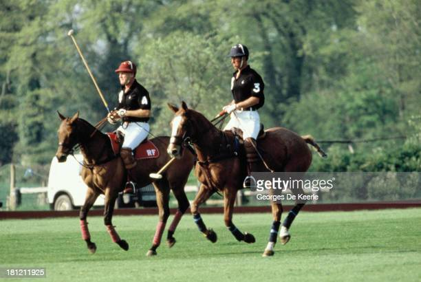 Charles Prince of Wales and his polo manager Major Ronald Ferguson play polo during the Polo Season Opening at Cirencester Park Polo Club on May 8...