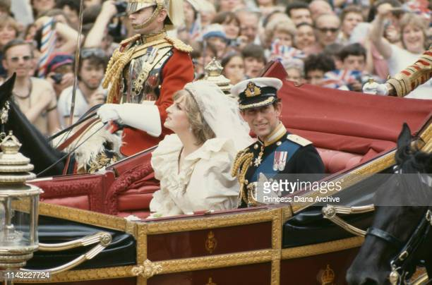 Charles, Prince of Wales, and his wife, Princess Diana , wave to the crowds following their wedding ceremony at St Paul's Cathedral, London, UK, 29th...