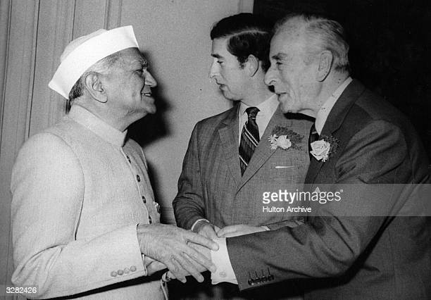 Charles Prince of Wales and Lord Louis Mountbatten greeting a dignitary during a visit to Delhi to lay a wreath on Mahatma Gandhi's shrine