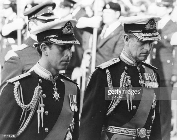 Charles Prince of Wales and Prince Philip Duke of Edinburgh attending the funeral of Earl Louis Mountbatten in full Naval regalia