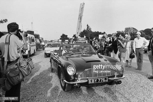 Charles Prince of Wales driving his Aston Martin DB5 Volante Convertible sports car with his wife Diana Princess of Wales in the passenger seat as...