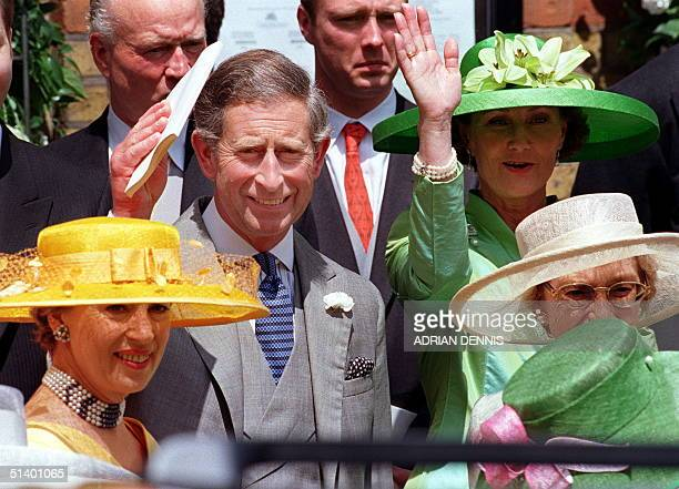 Charles, Prince of Wales gives a wave to his mother Queen Elizabeth II as she departs St.Sophia Cathedral after the wedding of Princess Alexia,...