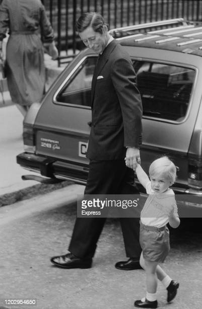 Charles, Prince of Wales holding the hand of his son Prince William on their at the Lindo Wing of St Mary's Hospital to visit and Diana, Princess of...