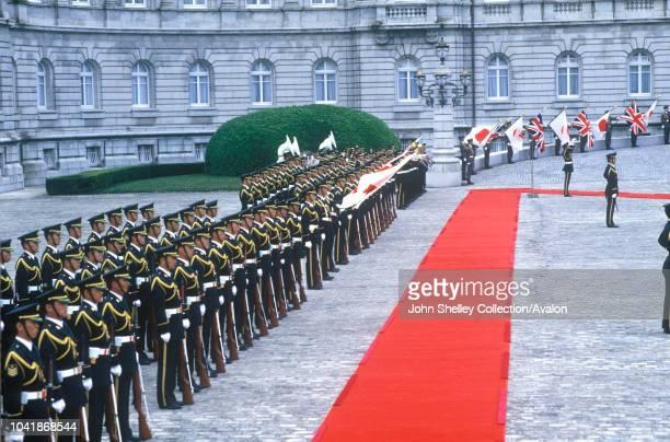 Charles, Prince of Wales, inspects a guard of honour at the Akasaka Palace, Tokyo, Japan, 10th May 1986.