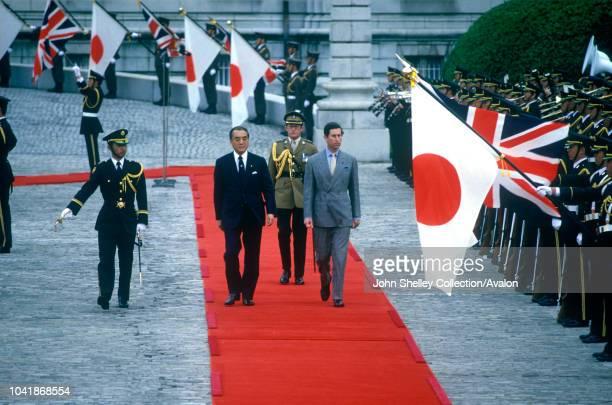 Charles, Prince of Wales, inspects a guard of honour at the Akasaka Palace, Tokyo, Japan, Accompanied by Mr Yasuhiro Nakasone and behind is his...