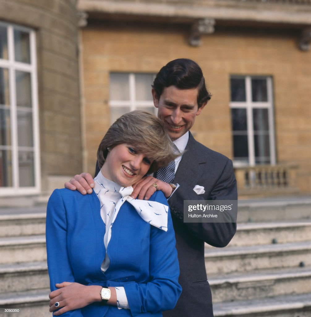 Charles, Prince of Wales laughing with his fiancee Lady Diana Spencer (1961 - 1997) outside Buckingham Palace, London after announcing their engagement.