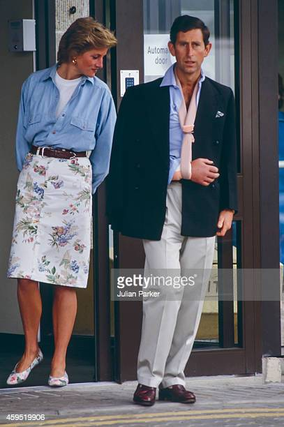 Charles Prince of Wales leaves Cirencester Hospital with his arm in a sling after a Polo accident accompanied by Diana Princess of Wales on July 1...