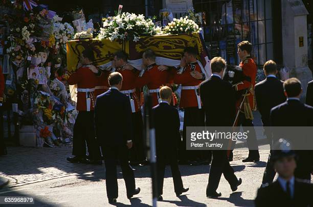 Charles Prince of Wales Prince Harry Earl Spencer and Prince William walk behind Diana's casket during the funeral procession of Diana Princess of...