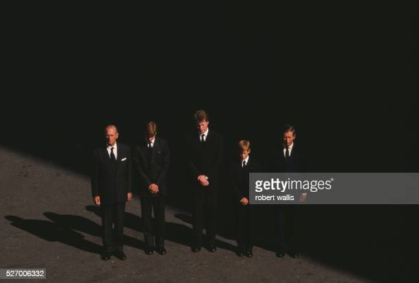 Charles Prince of Wales Prince Harry Earl Spencer Prince William and Philip Duke of Edinburgh bow their heads at the funeral of Diana Princess of...