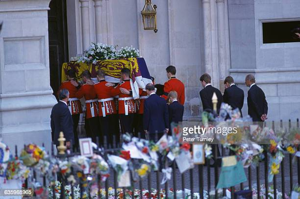 Charles Prince of Wales Prince Harry Earl Spencer Prince William and Philip Duke of Edinburgh walk behind Diana's casket as it is carried into...