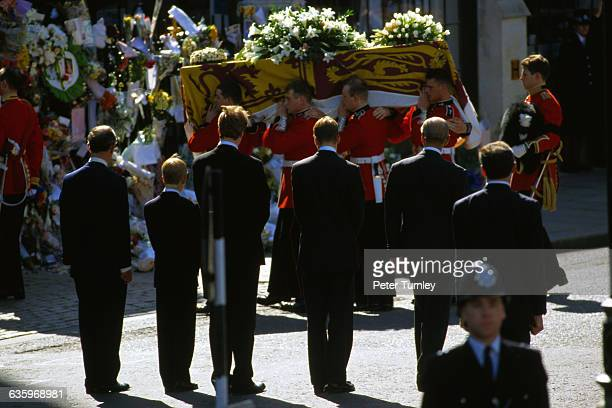 Charles Prince of Wales Prince Harry Earl Spencer Prince William and Philip Duke of Edinburgh stand behind Diana's casket during the funeral...