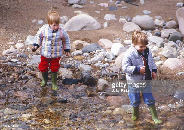 Charles Prince of Wales Prince William and Prince Harry play on the bank of the River Dee near Balmoral Estate Scotland on April 10 in Ballater...