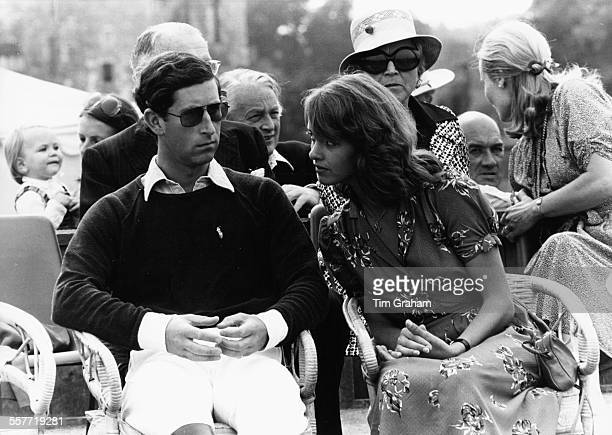 Charles, Prince of Wales, sitting with heiress Sabrina Guinness at a sports event, 1979.
