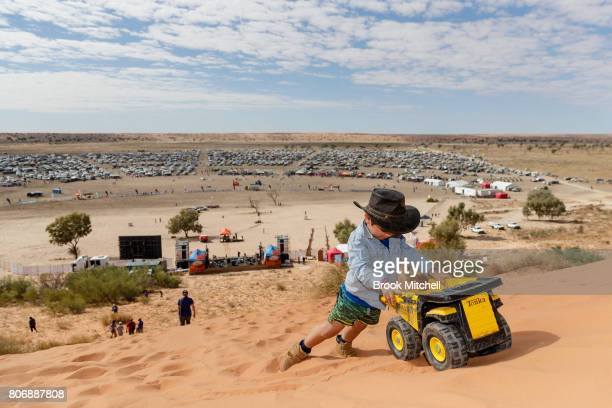 Charles pushes his Tonka Truck up the Big Red sand dune before the Birdsville Big Red Bash 2017 on July 4 2017 in Birdsville Australia
