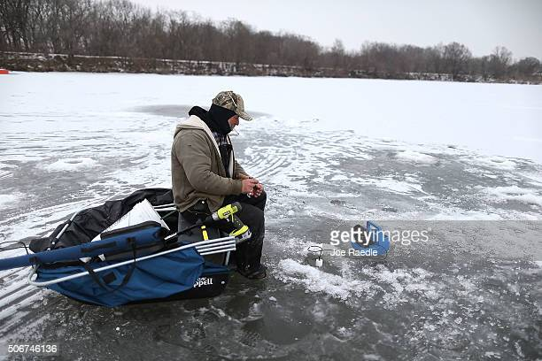 Charles Ratliff spends time icefishing on January 25 2016 in Independence Iowa Politicians criss crossing the state looking for votes before the Iowa...