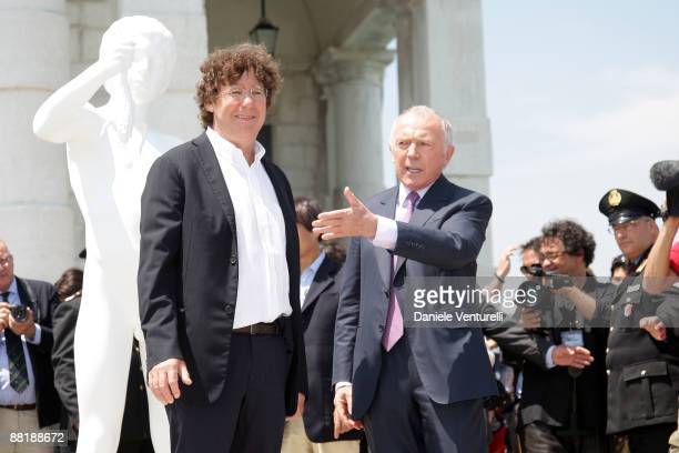 Charles Ray and Francois Pinault pose near 'The Boy with the Frog' by Charles Ray during the opening of The New Contemporary Art Centre at Punta...