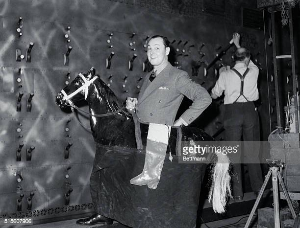 Charles Ray film star of the silent era riding a horse at the All Star Show of 1935 given in Los Angeles to help raise funds for incurable invalids...