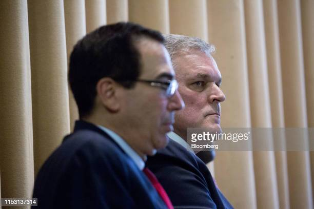 Charles Rettig, commissioner of the Internal Revenue Service , right, and Steven Mnuchin, U.S. Treasury secretary, listen during an IRS Criminal...
