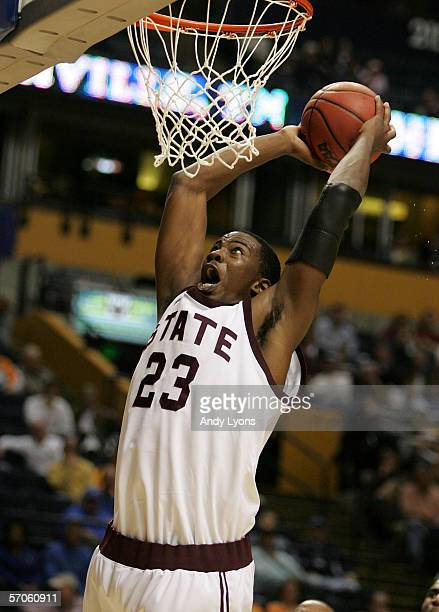 Charles Rhodes of the Mississippi State Bulldogs drives for a dunk attempt against the South Carolina Gamecocks during Day 1 of the SEC Men's...