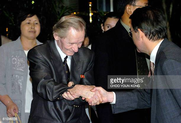 Charles Robert Jenkins an alleged US army deserter is greeted by the hotel manager after he arrived at the hotel with his Japanese wife Hitomi Soga...