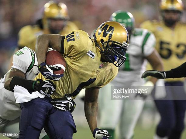 Charles Roberts of the Winnipeg Blue Bombers tries to break a tackle against the Saskatchewan Rough Riders during the first quarter of the 95th Grey...