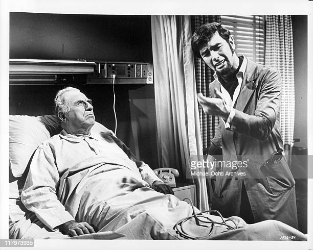 Charles Robinson tries to convince hospitalized Ed Begley that his nephew can be a big recording star in a scene from the film 'A Time to Sing' 1968