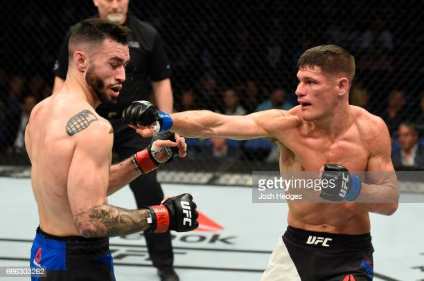 Charles Rosa lands a punch on Shane Burgos in their featherweight bout during the UFC 210 event at KeyBank Center on April 8 2017 in Buffalo New York