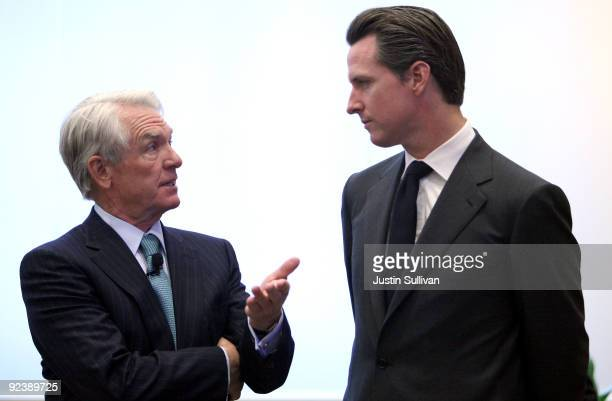 Charles Schwab Corp founder and chairman Chuck Schwab talks with San Francisco mayor Gavin Newsom during the grand opening of the new Charles Schwab...