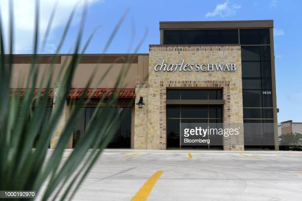 Signage is displayed outside a Charles Schwab Corp location in San Antonio Texas US on Sunday July 15 2018 Charles Schwab Corp is scheduled to...