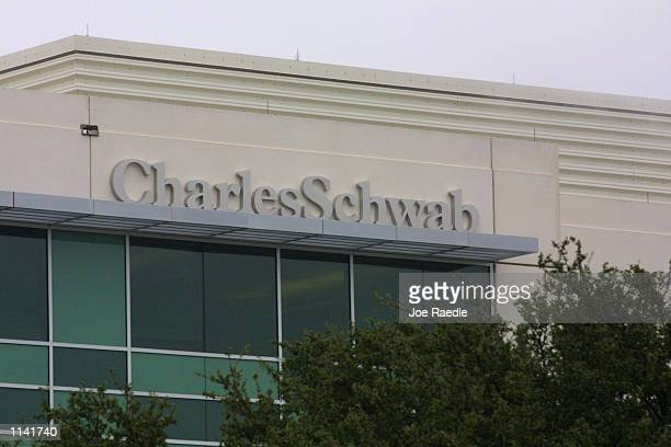 Charles Schwab sign hangs on the side of the building January 12 2001 in Austin Texas The company is expected to announced that it will have...
