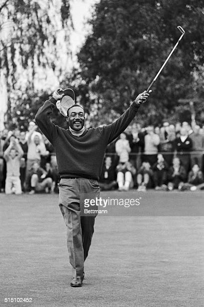 Charles Sifford of Los Angeles raises his putter jubilantly in the air after defeating South Africa's Harold Henning in a sudden death playoff during...