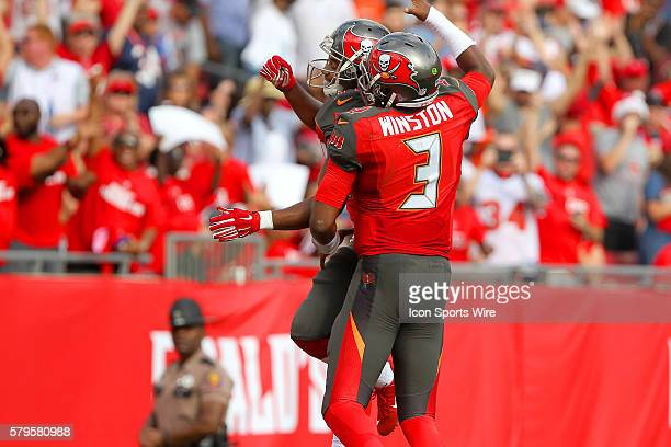 Charles Sims III of the Buccaneers celebrates his touchdown with his quarterback Jameis Winston during the NFL game between the Chicago Bears and...