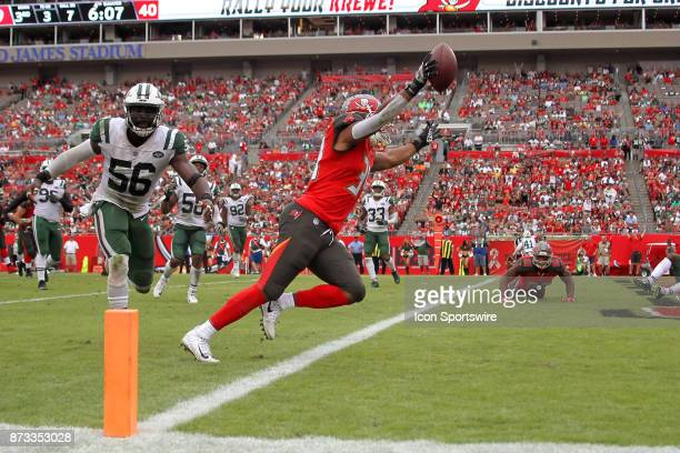 Charles Sims III of the Buccaneers makes the catch and runs into the end zone for the touchdown during the regular season game between the New York...