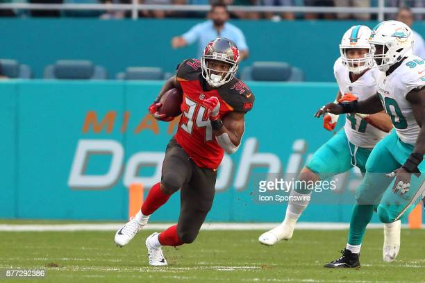 Charles Sims III of the Bucs carries the ball during game between the Tampa Bay Buccaneers and the Miami Dolphins on Sunday Nov 19 2017 at Hard Rock...